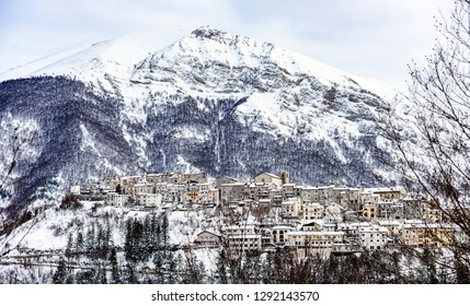 Aerial view of the beautiful snow-covered village of Opi with snow-capped mountains in the background. Opi is a comune and town in the province of L'Aquila in the Abruzzo region of central Italy.