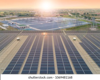 Aerial view of beautiful sunrise above the solar cell panel on the rooftop of electric power plant as futuristic on sustainability and innovation concept