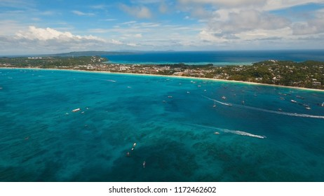 Aerial view of beautiful tropical island with white sand beach, Boracay, hotels and tourists. Tropical lagoon with turquoise water and white sand. Beautiful sky, sea, beach, resort. Seascape: Ocean