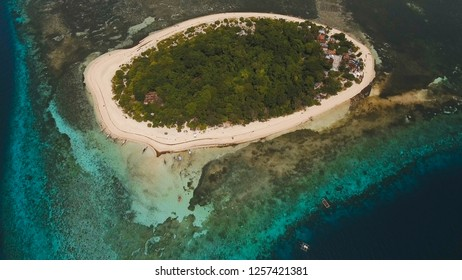 Aerial view of beautiful tropical island Mantigue with white sand beach,Camiguin. Beautiful sky, sea, resort. Seascape: Ocean and beautiful beach paradise. Philippines. Travel concept.