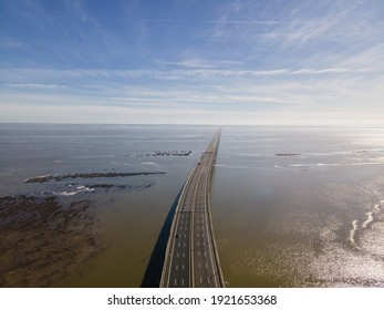 Aerial view of beautiful Vasco da Gama bridge's suspended highway road crossing the Tagus river, one of the world's longest bridge, Oriente district, Lisbon, Portugal.