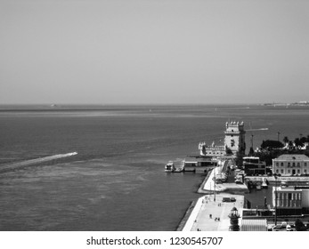 Aerial view of Belem District seen from Discoveries Monument. Belem Tower on the bank of Tagus river - fortified tower located in Lisbon, Portugal, Europe. UNESCO World Heritage Site. Black and white