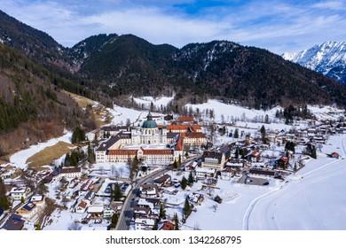 Aerial view, Benedictine abbey Ettal monastery in winter, Ettal, Oberammergau, Garmisch-Partenkirchen region, Bavaria, Germany, July 2019