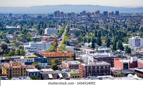 Aerial view of Berkeley and north Oakland on a sunny day; downtown Oakland in the background; San Francisco bay, California