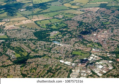Aerial view of the Berkshire town of Wokingham, seen on a sunny summer day.  The blue structure of the railway station's multi-story car park is at the centre.