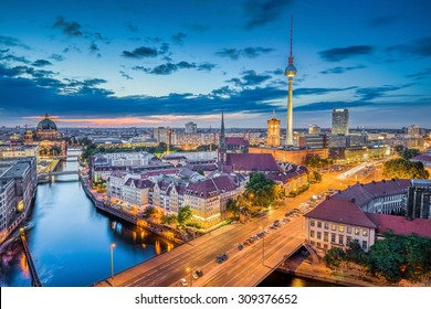 Aerial view of Berlin skyline with dramatic clouds in twilight during blue hour at dusk, Germany