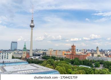 Aerial view of Berlin skyline with famous TV tower at Alexanderplatz and dramatic cloudscape at sunset, Germany