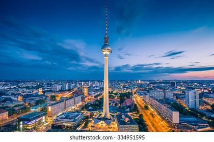 Aerial view of Berlin skyline with famous TV tower at Alexanderplatz and dramatic clouds in twilight during blue hour at dusk, Germany