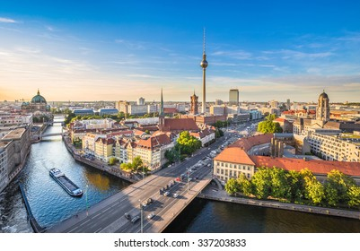 Aerial view of Berlin skyline with famous TV tower and Spree river in beautiful evening light at sunset in summer, Germany