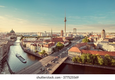 Aerial view of Berlin skyline with famous TV tower and Spree river in beautiful evening light at sunset with retro vintage Instagram style grunge pastel toned filter effect, Germany
