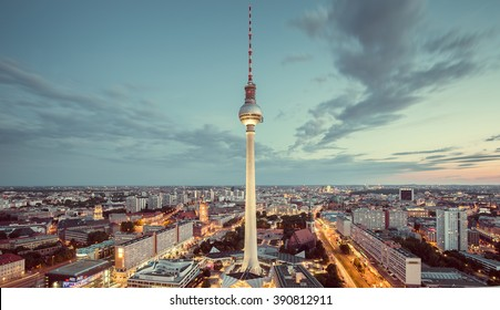 Aerial view of Berlin skyline with famous TV tower and dramatic clouds in twilight during blue hour at dusk with retro vintage Instagram style nostalgic pastel toned filter effect, Germany