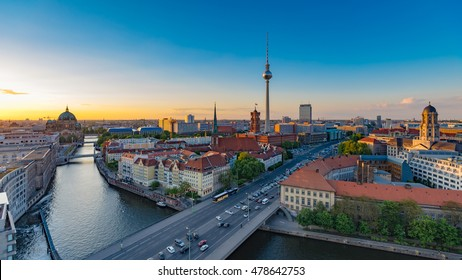 Aerial view of Berlin skyline with famous TV tower and Spree river at sunset in summer, Germany