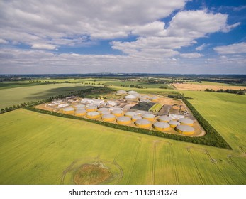 Aerial view of a big biogas plant between green agricultural fields in germany - green clean energy
