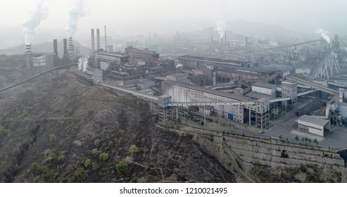 Aerial view of big factory in China.Air pollution by smoke coming out of chimneys. Coal Fossil Fuel Power Plant Smokestacks Emit Carbon Dioxide Pollution. Chengde, China. 10/22/2018
