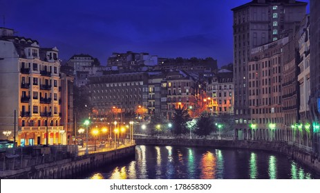 Aerial view of Bilbao, Spain city downtown with a Nevion River at Night