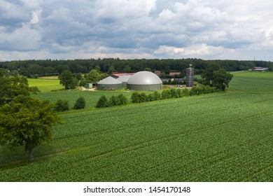 aerial view of a biogas plant between maize fields