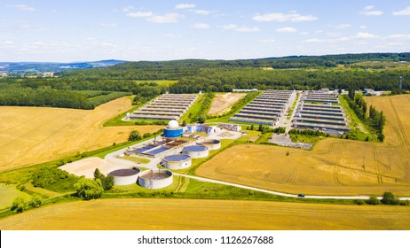 Aerial view of biogas plant and pig farm in countryside. Renewable energy from biomass. Modern agriculture in Czech Republic, European Union.