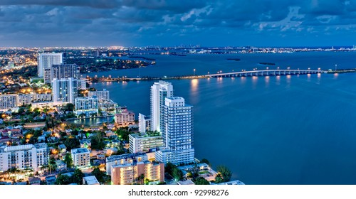 Aerial view of Biscayne Bay and Miami Beach at night.