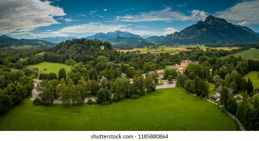 Aerial view of the bishop's summer palace residence in Hellbrunn near Salzburg Austria with the Alps in the background