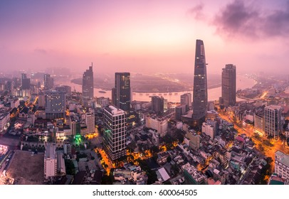 Aerial view of Bitexco Financial Tower  building, Century Link, train tracks, buildings, roads, and Saigon river in Ho Chi Minh city.High quality stock image panorama