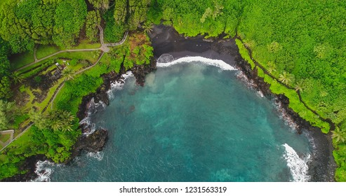 An aerial view of the Black Sand Beach in  Waianapanapa State Park along the Road to Hana in East Maui, Hawaii.