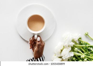 Aerial view of black woman drinks coffee