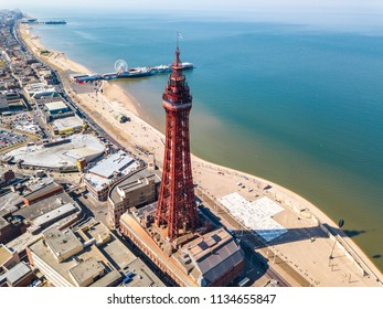 An aerial view of the Blackpool Tower with the Central pier in the background located in Blackpool, UK