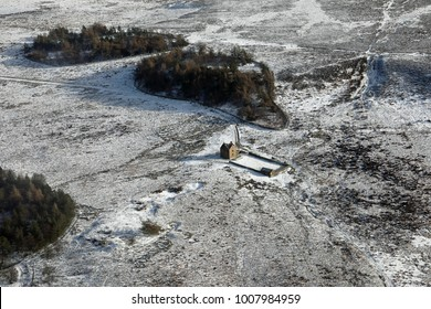 aerial view of a bleak house on the Pennines near Sheffield, UK