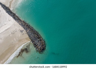 Aerial View of The Blue Green Ocean, Rocks Path in New Zealand - Auckland Area