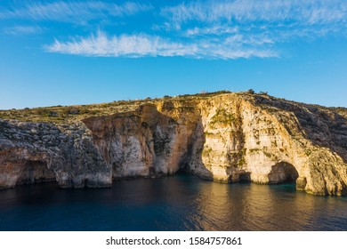 Aerial view of Blue grotto, caves, cliffs. Blue clear sky with clouds, winter, rocks. Malta country