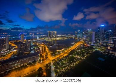 Aerial view of blue hour sunrise at Marina Bay Singapore city skyline