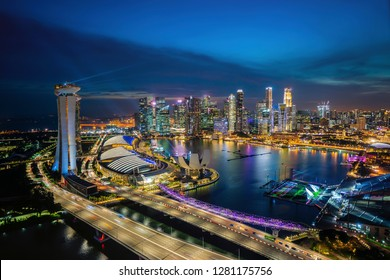 Aerial view of blue hour sunset dusk at Singapore Marina Bay city skyline.