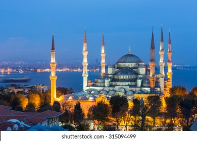 Aerial view of Blue Mosque in Istanbul at night. This is one of the most important islamic place where people go to pray. On background there are Bosphorus strait and Asian side of the city.