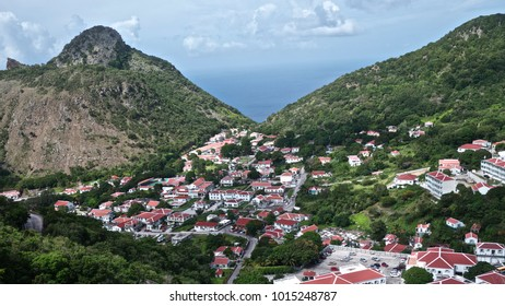Aerial view of blue ocean and red roofed Village in Saba, Caribbean