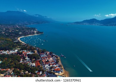 Aerial view of a blue sea and clear weather. Fantastic landscape. Great beach view. Ilhabela, São Paulo, Brazil. Travel, vacation, destination, tourism point, tranquility, dream, peace. Ilha Bela.