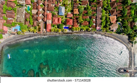 Aerial view of the blue water coast line in Candidasa Beach, Bali, Indonesia.