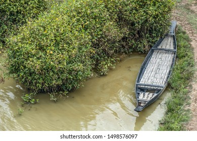 An aerial view of a boat for transport in a flooded area of rural Asia.