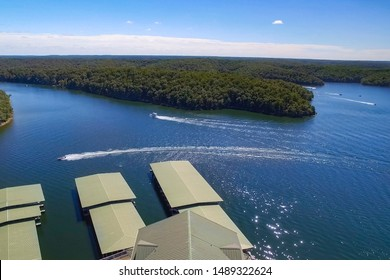 Aerial view of boating at the Lake of the Ozarks Missouri with nearby docks on a sunny summer day