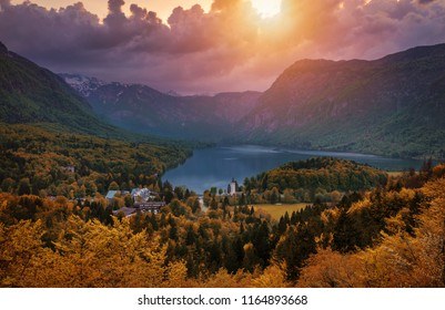 Aerial view of Bohinj lake in Julian Alps. Breathtaking view of the famous Bohinj lake from above. Beautiful view of the Triglav national park and the church of St John the Baptist. Slovenia, Europe