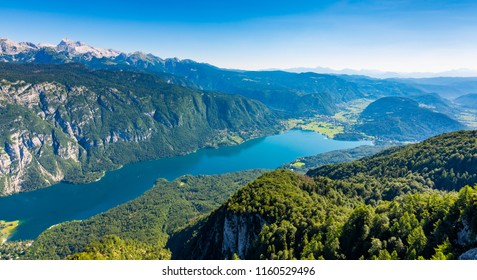 Aerial view of Bohinj lake from Vogel cable car station. Mountains of Slovenia in Triglav national park. Julian alps landscape. Blue water, summer sky, mountains in the bakcground.