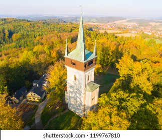 Aerial view to The Bolfanek viewtower with the St. Wolfgang´s cemetery chapel. Near a  marvelous village Chudenice from 12th century. Czech landmarks from above. Autumn in Central Europe.
