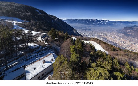 Aerial view of Bolzano city from the top of Colle mountains