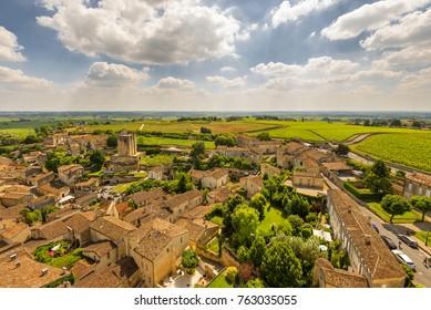 Aerial view of Bordeaux famous wine production town Saint émilion or saint emilion with vineyards and sky at the background.