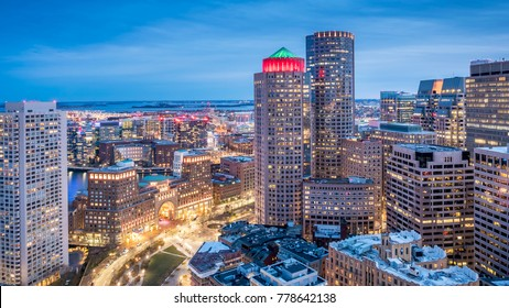 Aerial view of Boston in Massachusetts, USA at night showcasing the Boston Harbor and Financial District.