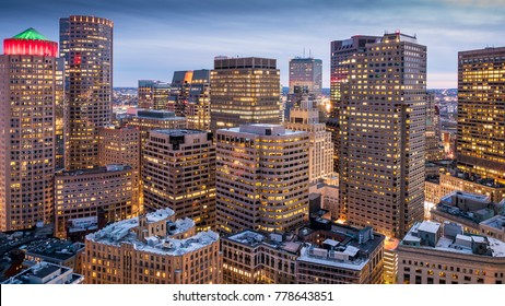 Aerial view of Boston in Massachusetts, USA at night showcasing the skyscrapers of its Financial District.