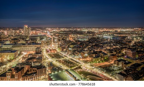 Aerial view of Boston at night in Massachusetts, USA showcasing the architecture of its North End and Italian District.