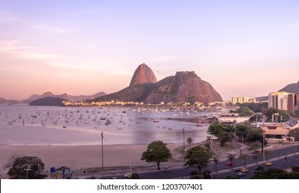 Aerial view of Botafogo, Guanabara Bay and Sugar Loaf Mountain with a pink sunset - Rio de Janeiro, Brazil