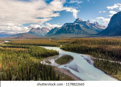 Aerial view of the Bow River and Canadian Rockies during summer at Banff National Park in Alberta, Canada.