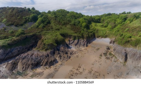 Aerial view of Brandy Cove on the South side of the Gower peninsula in Swansea, UK, which was used as a smugglers cove in years gone by.