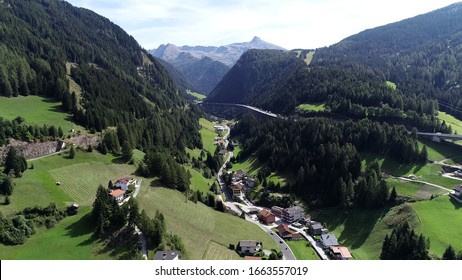 Aerial view of Brenner Pass in German language Brennerpass is mountain road through Alps which forms border between Italy and Austria it is one of the principal passes of the Eastern Alpine range